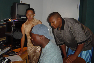 Sheril, Lawren and Anthony working out the script!