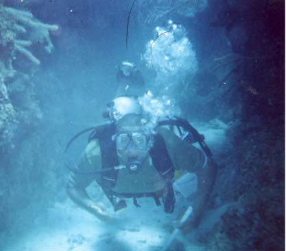 Anthony in tunnel, Little Cayman. Dive In Camea