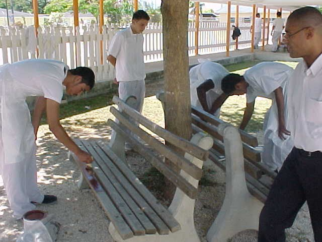 Asdan students painting benches for Earth Day