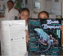 Tracy and Adlin holding the Blue Dragon posters