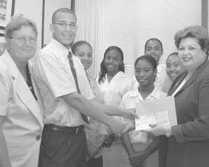 JGR receive a cheque for CI$5,000 from Mrs Basdeo